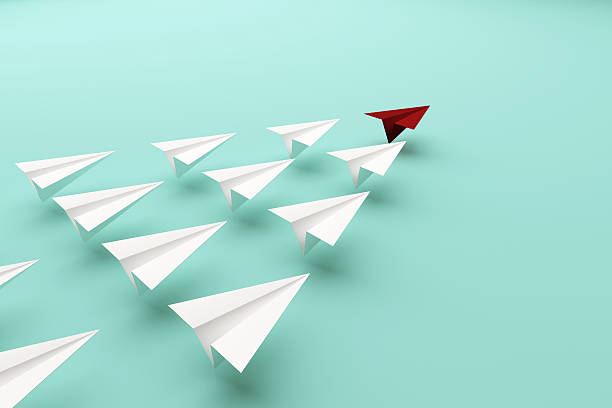 Red paper plane of leading leadership concept stock photo