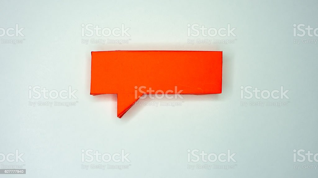 Red paper speech bubble on white background stock photo