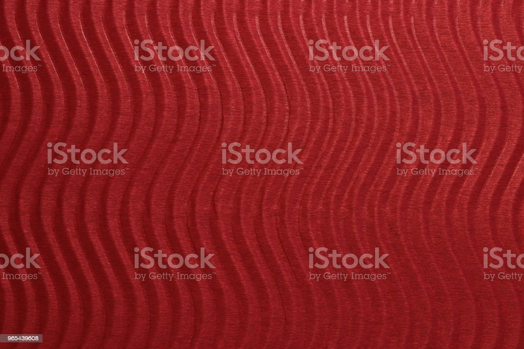 Red Paper Vertical Waves Texture. Embossed Waves on Detailed Paper Background. Corrugated Wavy Cardboard Backdrop. royalty-free stock photo