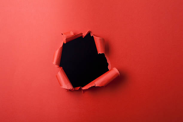 Red paper with hole. stock photo