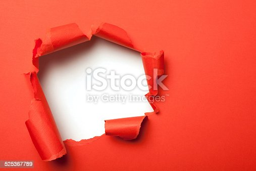 472273278 istock photo Red paper with hole 525367789