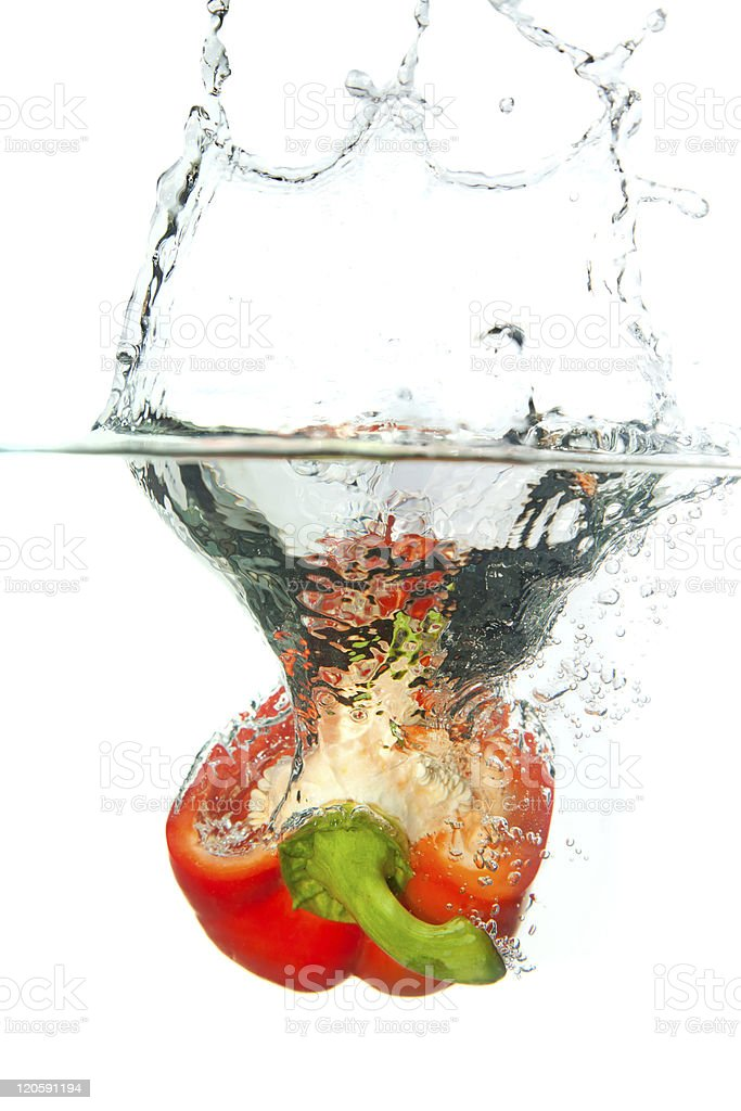 Red paprika in water splash isolated on white royalty-free stock photo