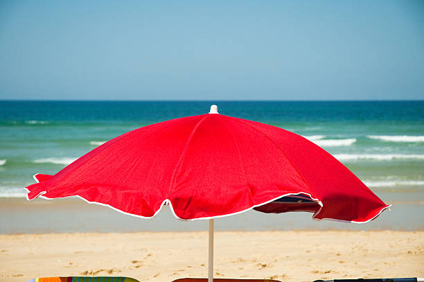 red parasol stock photo