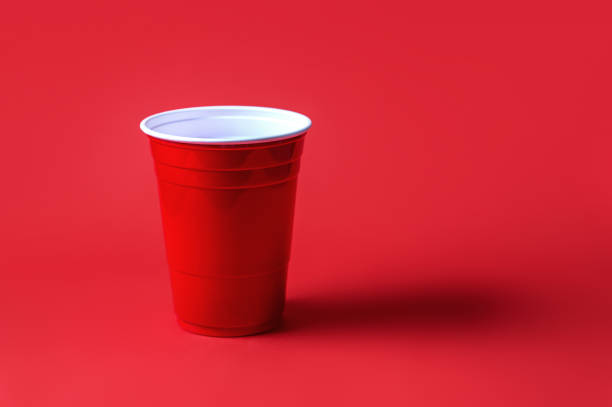 Red party cup on red background. Beer pong tournament or college celebration. stock photo