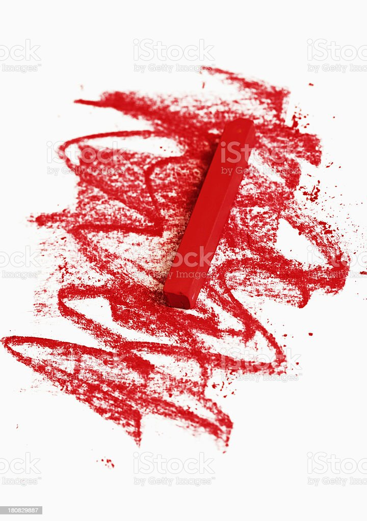 Red pastel crayon chalks and scribbles on white sketchpad stock photo