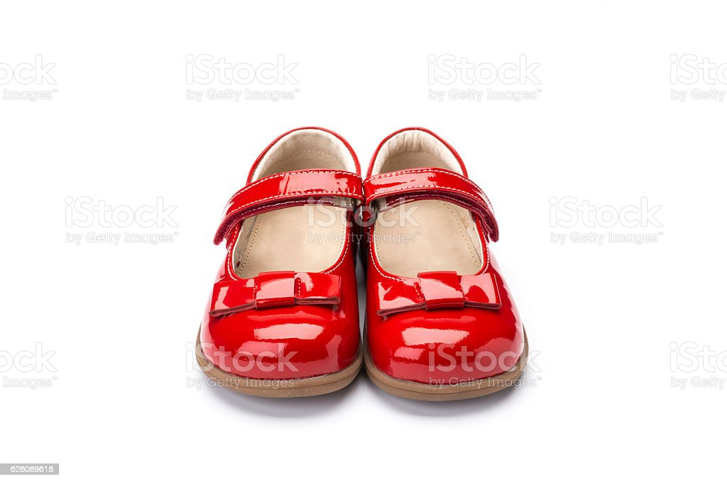 red patent leather childrens shoe on a white background stock photo