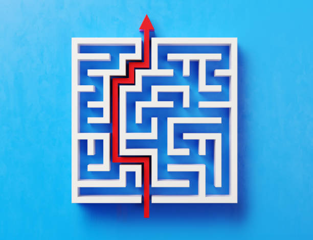 red path across a white maze on blue background - maze stock photos and pictures