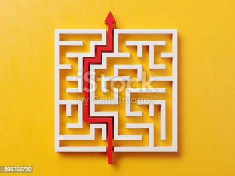 istock Red Path Across A White Maze On Yellow Background 899266730