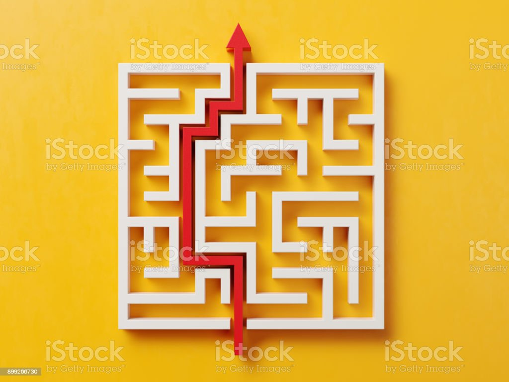 Red Path Across A White Maze On Yellow Background stock photo