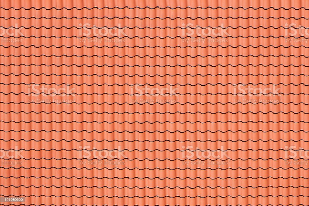 A red patterned roof as a background stock photo