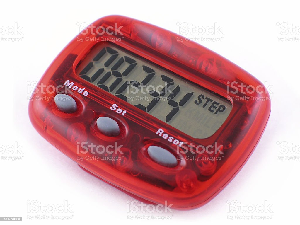 Red pedometer reader on a white table royalty-free stock photo