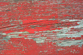istock Red peeled shabby wooden background 1000250930