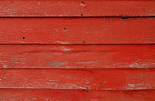 istock Red peeled shabby wooden background 1000251730