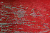 istock Red peeled shabby wooden background 1000257116