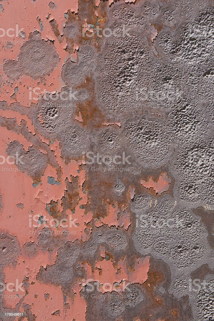 Red Peeling Paint on Dented Metal Texture royalty-free stock photo
