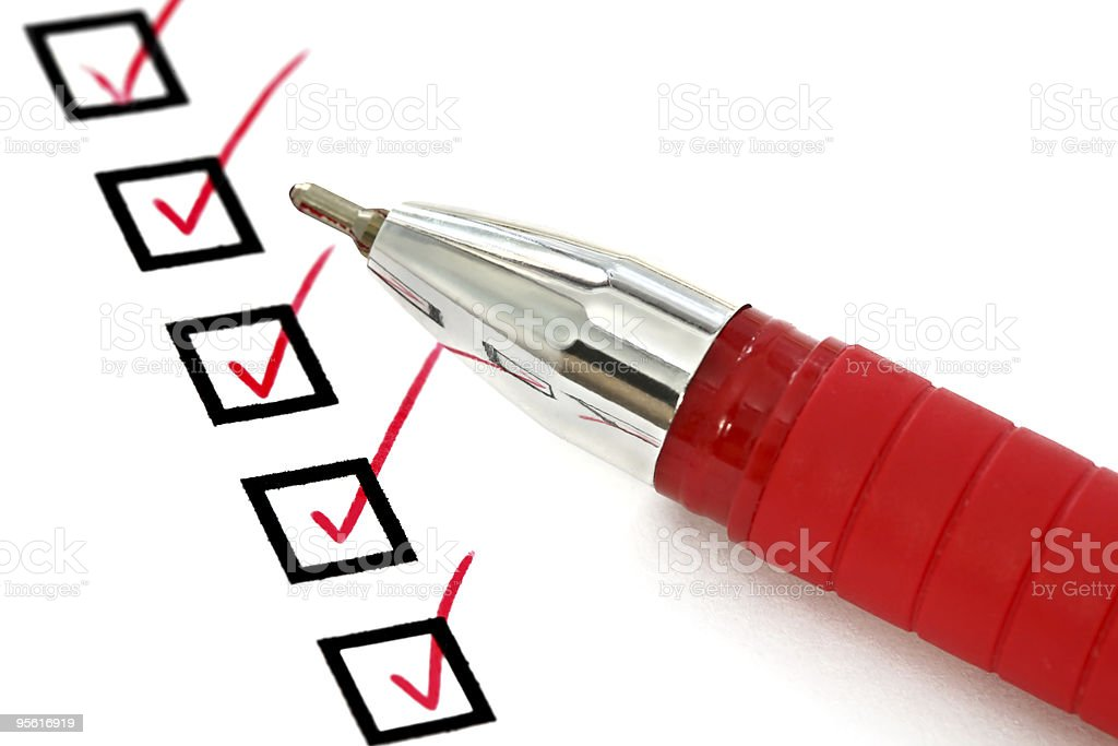 Red Pen and Checklist royalty-free stock photo