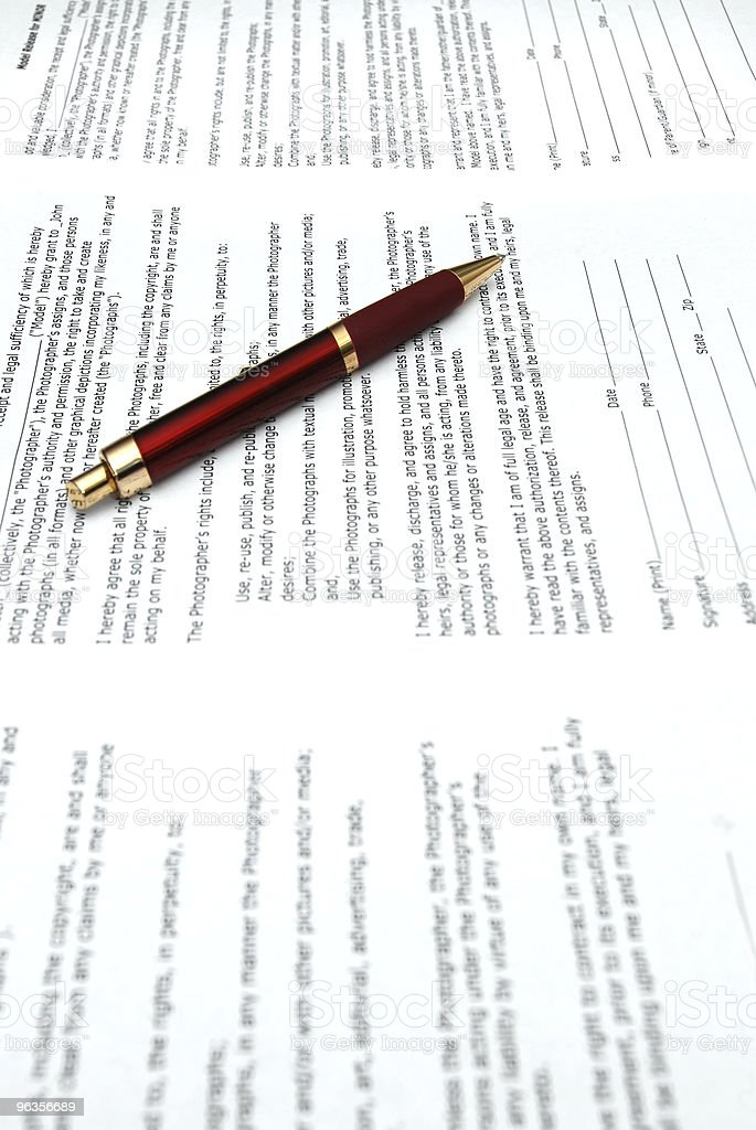 Red Pen and Multiple Contracts royalty-free stock photo