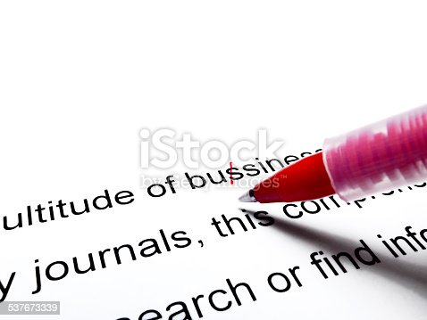 istock Red pen correcting proofread english text close up 537673339