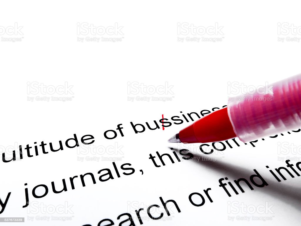 Red pen correcting proofread english text close up stock photo