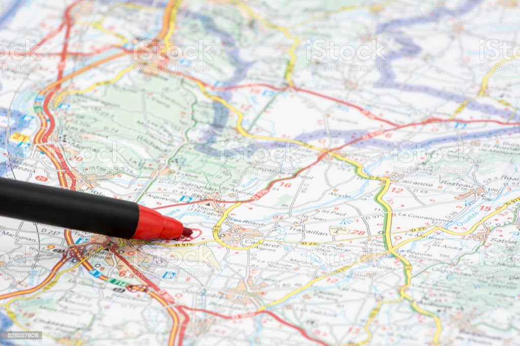 red pen marking the tourist destination on a map stock photo