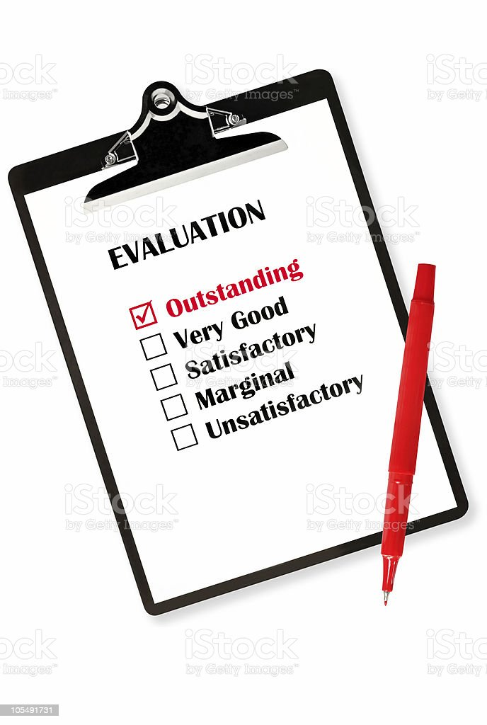 Red pen on clipboard with evaluation checklist stock photo