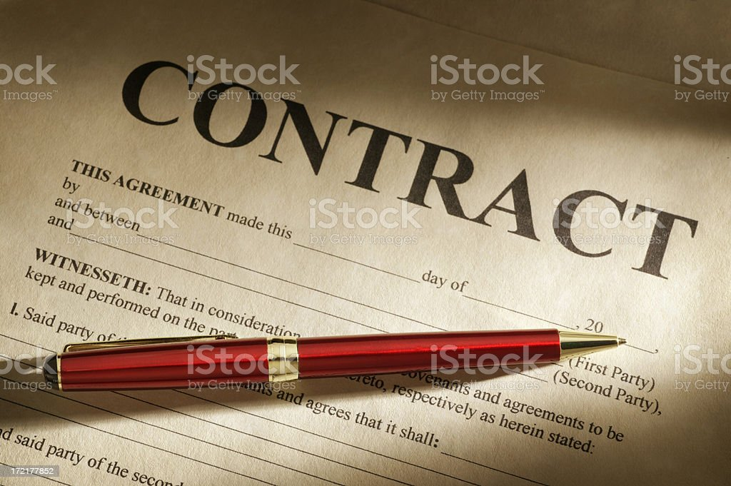 Red pen sitting on an unsigned contract stock photo