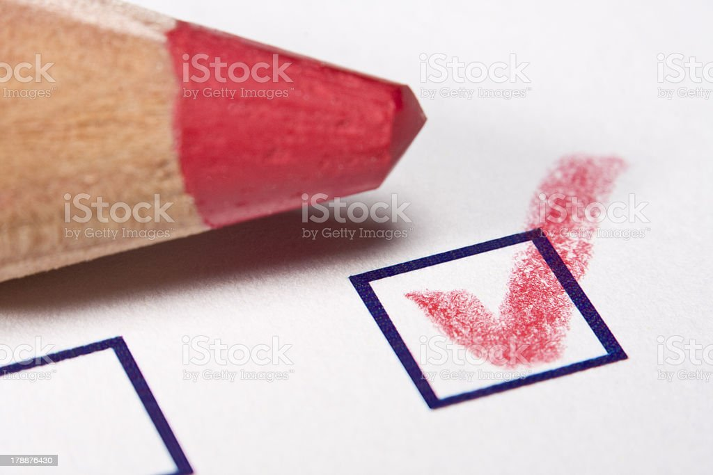 red pencil - checked royalty-free stock photo