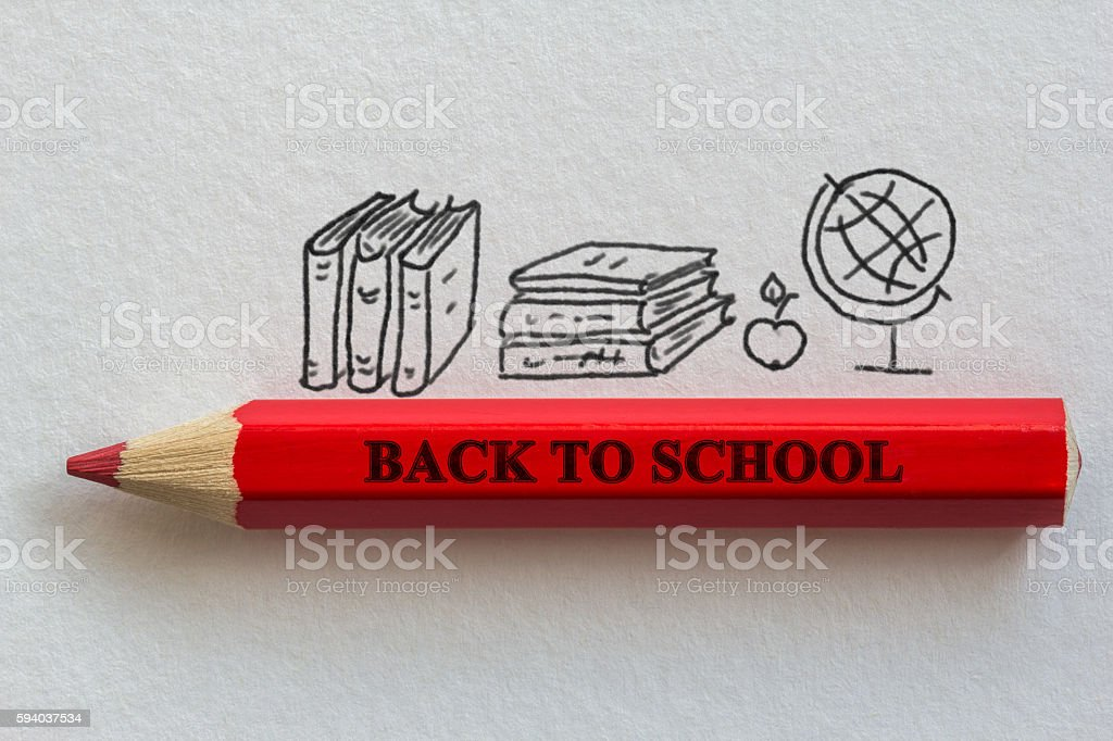 Red pencil on paper background stock photo