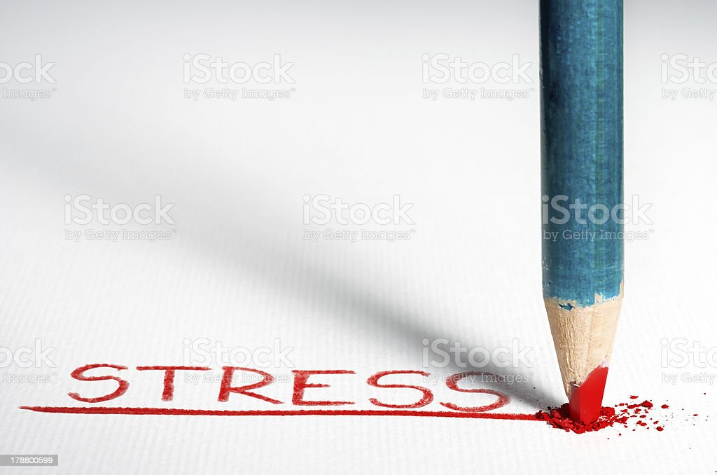 Red pencil spelling out STRESS royalty-free stock photo