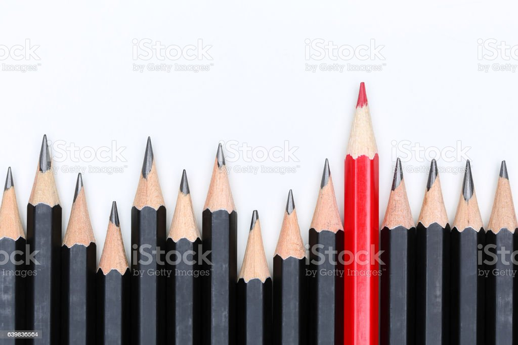 Red pencil standing out from crowd of plenty identical fellows stock photo