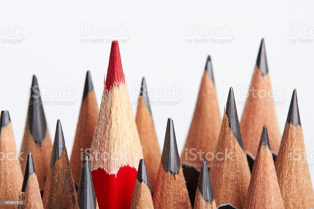 Red pencil standing out from crowd stock photo