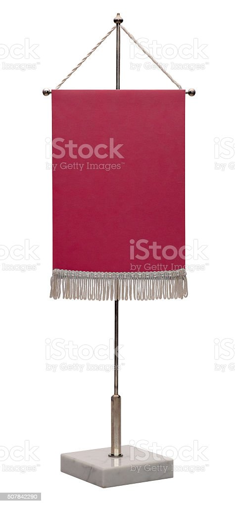 Red pennant on steel spire on a marble pedestal. stock photo