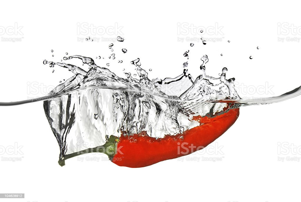 red pepper dropped into water stock photo