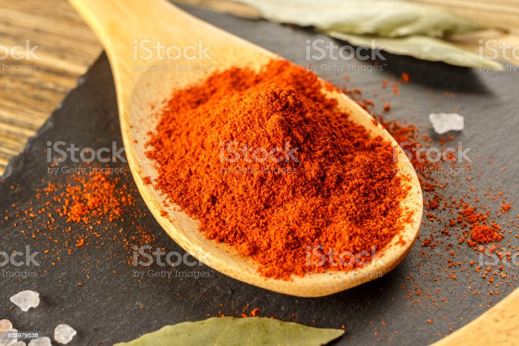 Red pepper ground. Spicy seasoning, on the kitchen table, Close-up. stock photo