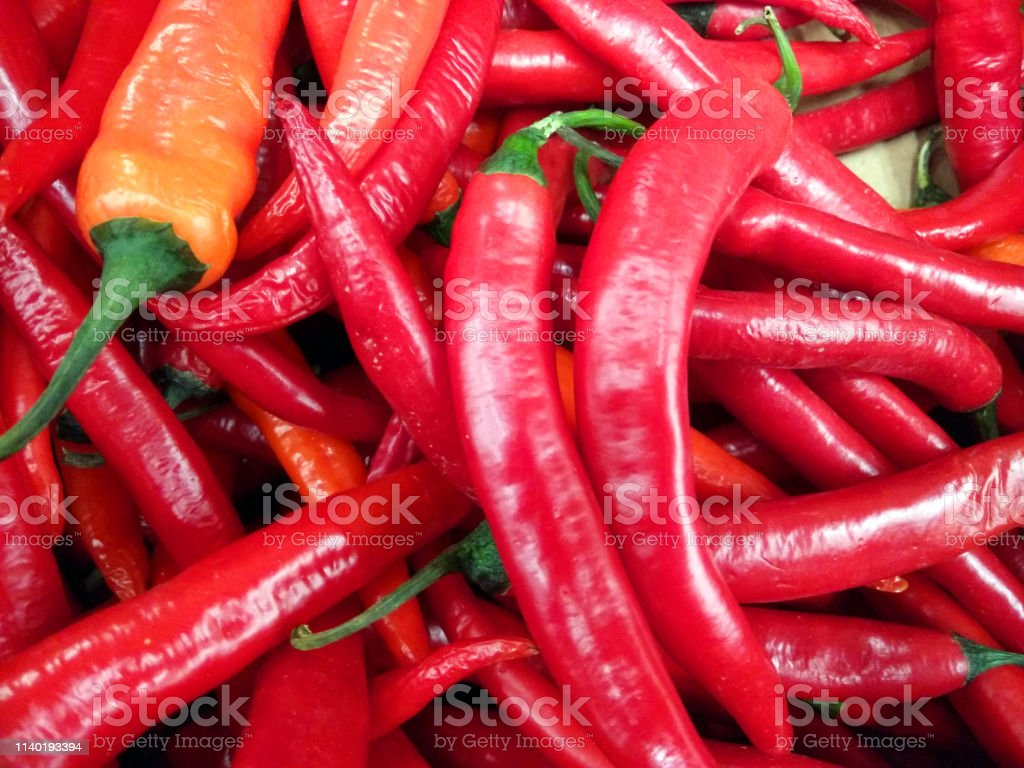 Red peppers background texture of hot red chili, seasoning paprika,...