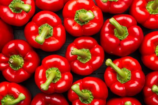 red peppers full frame on black background