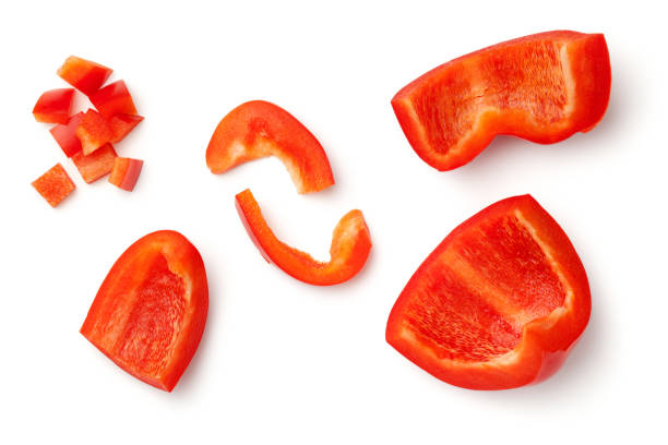 red peppers isolated on white background - red bell pepper isolated imagens e fotografias de stock