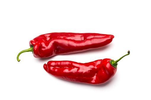 Red peppers on white background