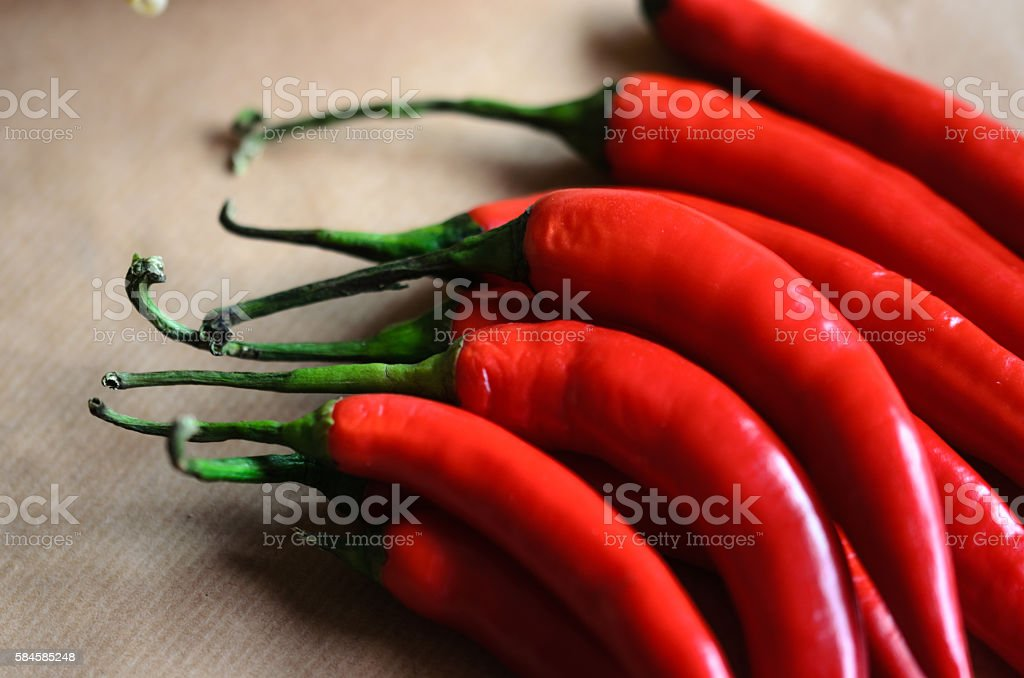 Red peppers over soft brown background stock photo