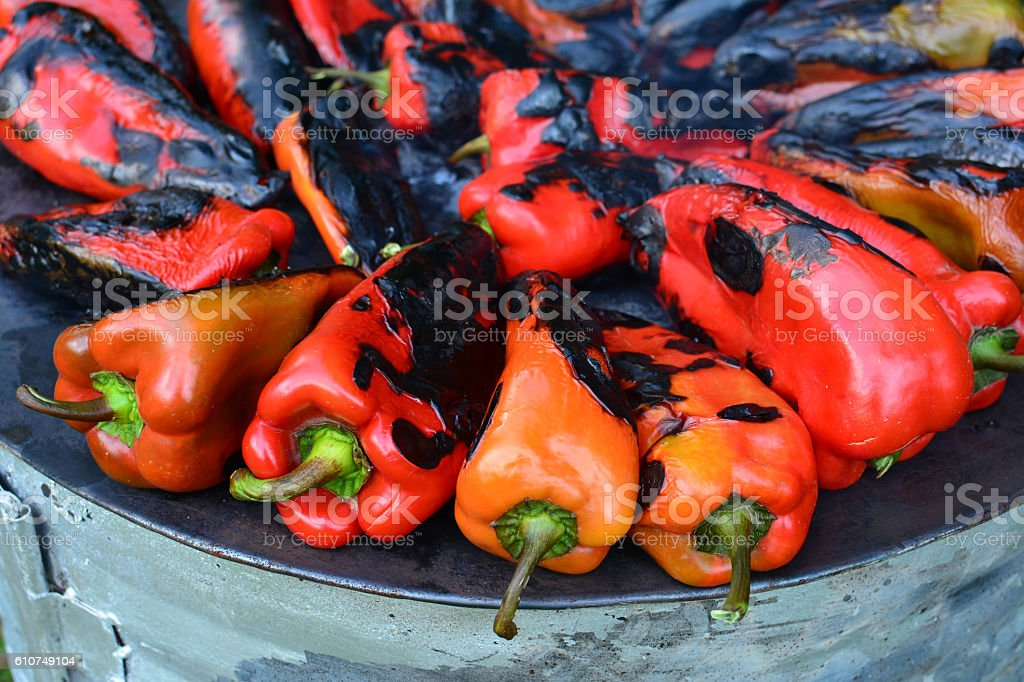Red peppers roasting stock photo