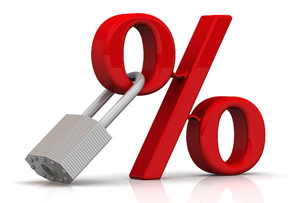red percent sign and a padlock - interest rate stock photos and pictures