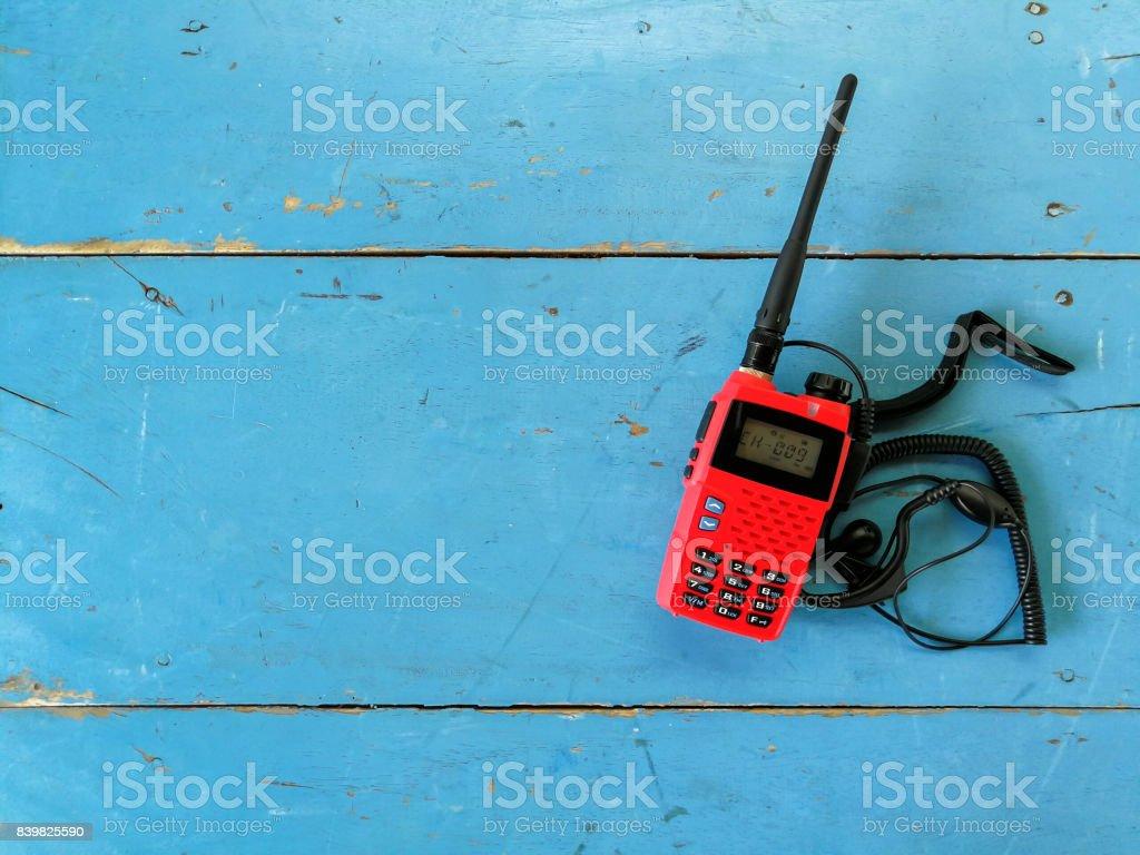 red Personal Radio  on wooden bakcground stock photo
