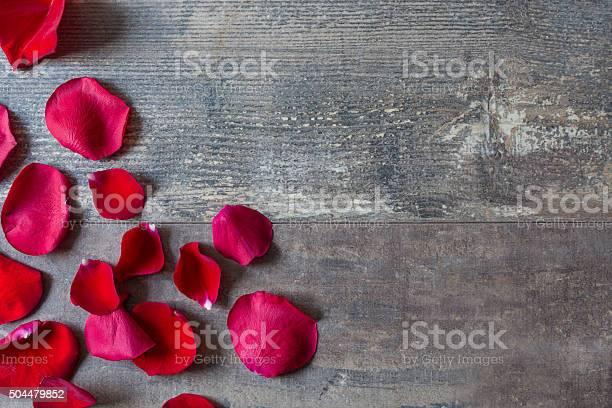 Red petals on wood picture id504479852?b=1&k=6&m=504479852&s=612x612&h=fbxd31htv d1nyi8gw5msy5hrlxryuflq rwjwwb8u8=