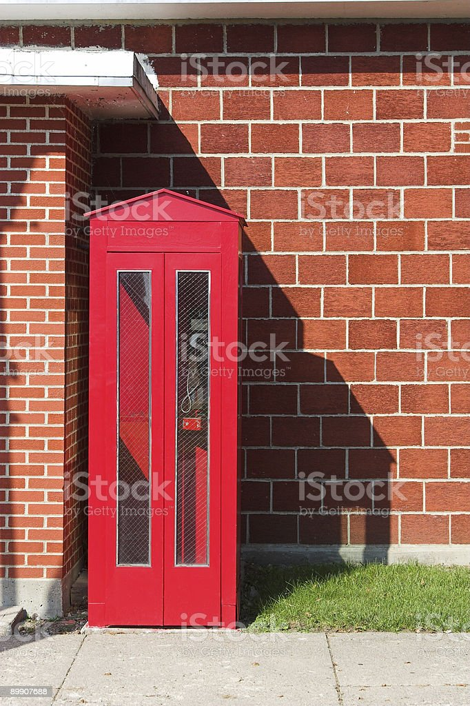 Red Phone Booth and Brick Wall royalty-free stock photo