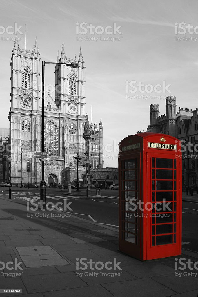 Red phone booth and the Westminster Abbey royalty-free stock photo