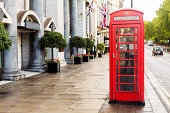 Red British phone booth on the streets of London
