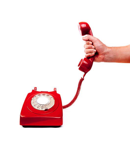 красный телефон - hand holding phone стоковые фото и изображения