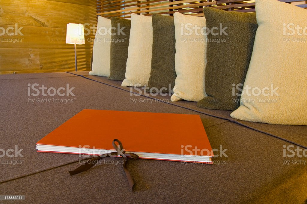 Red Photo Album Book on Bed with Pillows stock photo