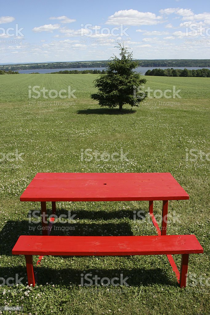 red pic nic table in a sunny canadians day royalty-free stock photo