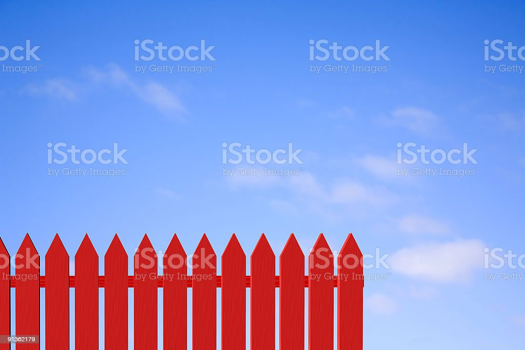 Red Picket Fence and Blue Sky royalty-free stock photo